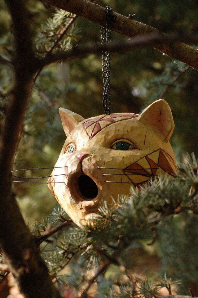 This unconventional birdhouse adds a touch of whimsy to the garden. It has a trap door at the bottom so you can clean it out over the winter, and sanitize it for the next bird family. There's been a family in this feline birdhouse every year!