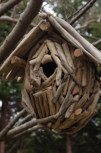 This rustic twig inspired birdhouse is a favorite of wrens